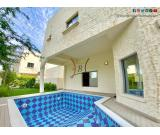 Charming Villa with Private Pool and Garden in Janabiya